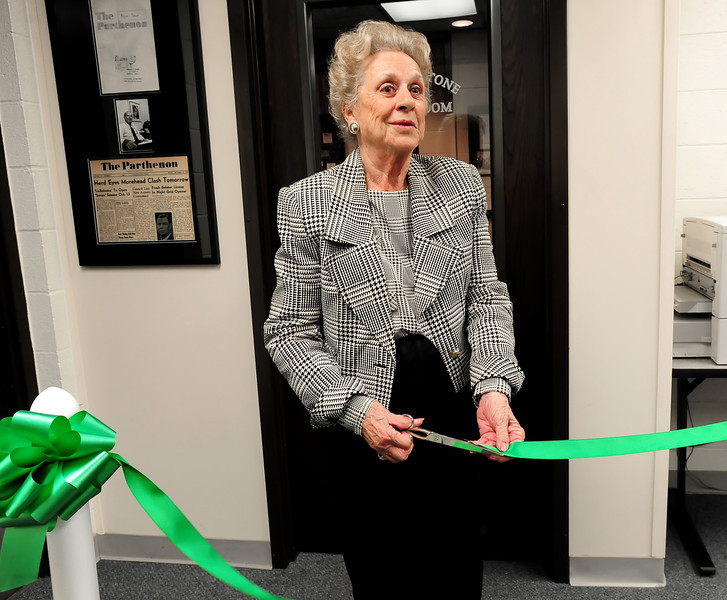 Terry Stone cuts the ribbon to officially open the Marvin L. Stone Reading Room at Marshall University.