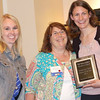 Jana Hovland (far right) received the 2014 Outstanding Young Dietician Award at the annual WVAND state conference. Hovland serves as director of the Marshall University DPD program and as a member of the National Nutrition Month committee for WVAND. With her in the picture are Mallory Mount (left), scholarship and awards chair for WVAND, and Sharon Maynard of the American Dairy Association Midwest.