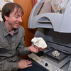 Dr. Paul Constantino, assistant professor of biology at Marshall University,  holds a skull created in MU's 3-D printer.