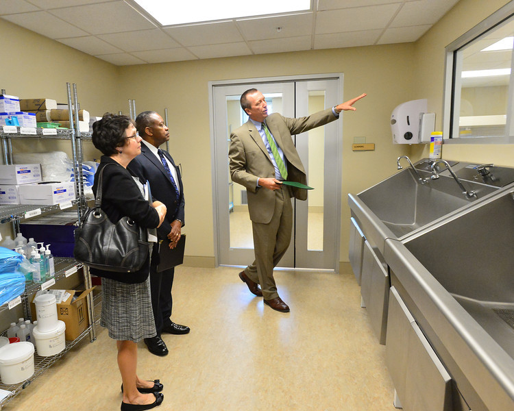 Dr. Kevin Yingling, dean of the Marshall University School of Pharmacy, leads Dr. Katherine Harper, left, dean of West Virginia State University's College of Natural Sciences and Mathematics, and Dr. R. Charles Byers, provost and vice president for academic affairs at WVSU, on a tour of the School of Pharmacy at MU.