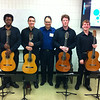 Marshall guitar ensemble students Kareem McCullough, Rodrigo Almeida, Jonathan Thorne and Erik Anderson stand with Associate Professor of Music and Brazilian native Dr. Júlio Alves (center) before their trip to Costa Rica.