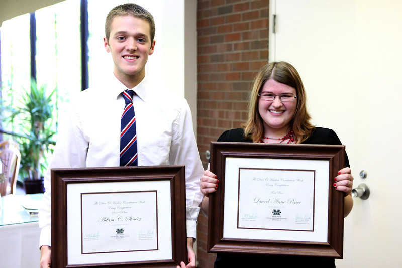 Laurel Peace, right, won the Dan O'Hanlon Essay Contest and Adam Shaver, left, finished second. Photo by Amanda Williams/Marshall University.