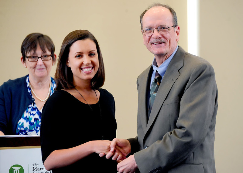Whitney Naylor-Smith of Hurricane, W.Va., took first place in two categories at the 2013 Maier Awards for writing. Here she is congratulated by Professor Art Stringer after receiving one of the awards as Dr. Jane Hill looks on.