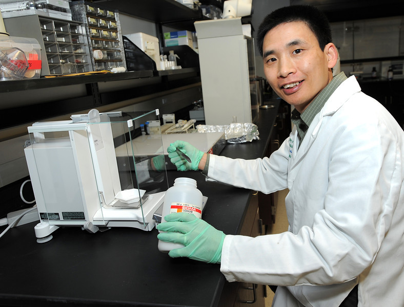 Dr. Miaozong Wu of the Marshall University School of Pharmacy received one of 14 grants recently awarded to the university's faculty members and students for aerospace-related research and educational programs. Wu and his co-investigators Dr. Henry Driscoll and Dr. Eric Blough will use the $10,000 award from the NASA West Virginia Space Grant Consortium to explore how obesity and metabolic syndrome affect bone health. Photo by Rick Haye, Marshall University.