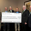 From left, James D. Thornburg, Bill Shewey, Dr. Ron Area, Bob Shewey, Marshall President Stephen J. Kopp and Gary White pose for a photo around an oversize check for $1.2 million presented to the Marshall Foundation March 19 in a ceremony at the Marshall University Foundation Hall, home of the Erickson Alumni Center. The $1.2 million will be given over a 20-year period by the C. Frederick Shewey Charitable Lead Annuity Trust. Thornburg and White are co-trustees of the trust, Bill and Bob Shewey are sons of the late C. Frederick Shewey, and Area is CEO of the Marshall Foundation.