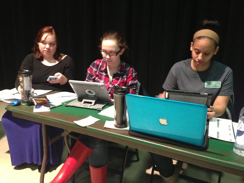 Marshall University theatre students (from left) Dakota Croy, Chelsey Moore and Monet Saffore are using digital technology, including an iPad, to perform stage management tasks.