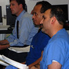 Dr. Faisal Hayat sits with Dr. Fikadu Tekleyes and Dr. David Francke and listens to Dr. Terry Shepherd's explanation of the CPETs. Hayat joined the Marshall Cardiology program in 2011 and believes what he learned during last week's demonstration will help him practice medicine with more understanding and accuracy.
