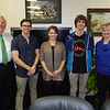 From left, President Stephen J. Kopp is joined by students Shane Craig, Jill Smallwood and John Fowler, along with Jane Kopp, in a photo Monday in the president's office. Fowler took first place, Craig was second and Smallwood placed third in the Holiday Printed Card division of the President's Holiday Design Contest.