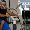 "Caleb Hill, 23, of Boone County, W.Va., is a graduate assistant in the department of exercise science. Hill served as the ""guinea pig"" for the clinical demonstration in which 12 fellows from Marshall Cardiology learned how CPETs can help save the lives of patients with various metabolic, cardiovascular and pulmonary problems."
