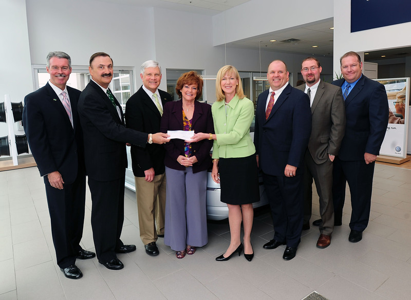 From left, Lance West,  Joe Gillette and Ron Area, all with the Marshall Foundation; Ruth Lemmon, president of the West Virginia Automobile and Truck Dealers  Association;  Barbara Atkins of Moses Honda Volkswagen; and  Donnie Potter, Kelly Schmitt and Mike Funk, all with Ally Auto,  take part in a check presentation Wednesday at Moses Honda Volkswagen in Huntington. Atkins was recently named West Virginia's 2013 Time Dealer of the Year nominee and received $1,000 from Ally to be donated to a charity of Atkins' choice. She chose the Yeager Scholars program at Marshall University to receive the $1,000, plus a $1,000 match from Moses Honda Volkswagen for a total donation of $2,000 to the Yeager program.