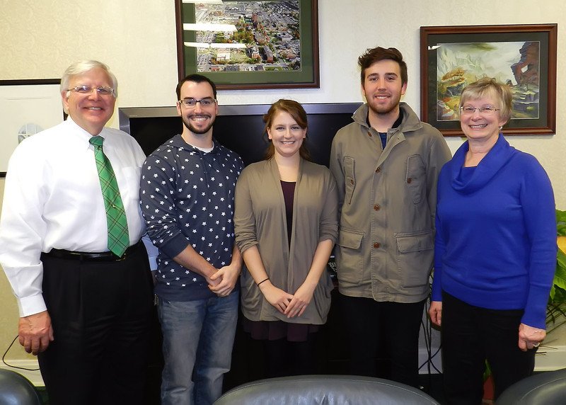 From left, President  Stephen J. Kopp is joined by students David Pelts, Jill Smallwood and John Dingess, along with Jane Kopp in a photo Monday in the president's office. Pelts and Dingess tied for first place, and Smallwood was third in the Commemorative Plate division of the President's Holiday Design Contest.