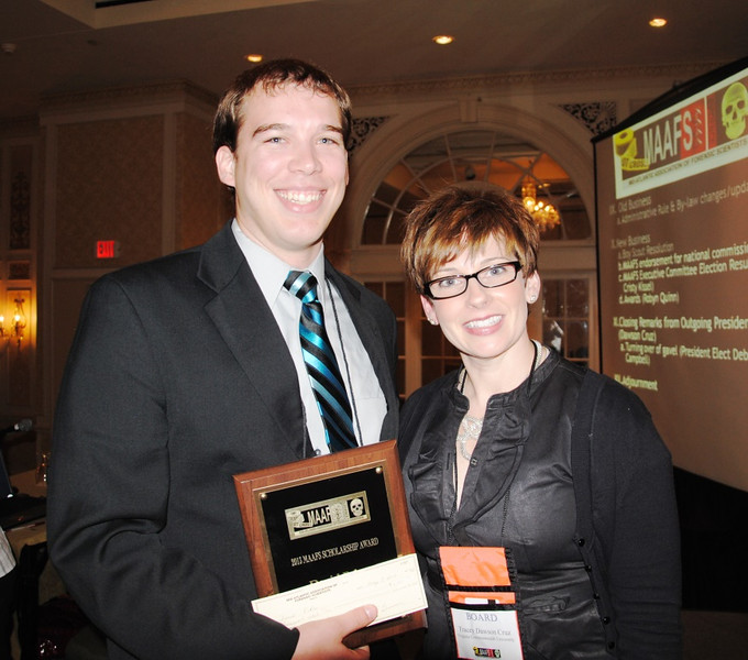 David Eckre (left), a spring graduate of the Marshall University Forensic Science Graduate Program, receives a $1,000 scholarship award and plaque from Dr. Tracie Cruz, president of the Mid-Atlantic Association of Forensic Sciences, at its annual meeting held this year in Roanoke, Va.