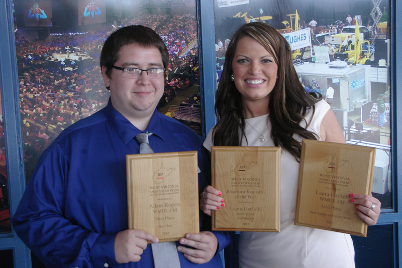 Adam Rogers, left, a senior from Charleston, and Laura Hatfield, a graduate student from Chapmanville, show off their first-place awards after the West Virginia Associated Press Broadcasters Association's awards ceremony June 8 in Charleston.