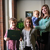 Owen Moul's children pose with their dad's diploma they received Feb. 1 from Marshall University. From left to right are Owen Jr., 7, holding the diploma; Sierra, 8, Zane, 1, and Sydney, 14. Photo by Liu Yang/Marshall University.