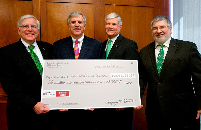 From left, Marshall President Stephen J. Kopp; Greg Burton, president and CEO of BrickStreet Mutual Insurance Company; Dr. Ron Area, CEO of the Marshall University Foundation; and Dr. Joseph Shapiro, dean of the university's Joan C. Edwards School of Medicine, display an oversized check for $2.5 million presented by BrickStreet Foundation to the Marshall University Foundation today at the BrickStreet office in Charleston. The donation will be used to establish a research endowment at Marshall. Photo by Rick Haye/Marshall University.
