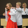 Ashton Weiss smiles as she receives her white coat from the chair of the School of Physical Therapy, Dr. Penny Kroll, during last Friday's White Coat Ceremony.