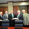 David L. Helmer, Senior Vice President and Regional Corporate Banking Manager for BB&T, third from left, presents a check for $100,000 to Marshall University President Stephen J. Kopp in support of the BB&T Center for the Advancement of American Capitalism at MU's College of Business. Also representing BB&T, from the left, are John Berry and Spencer Murphy, and from the right are Lance West and Dr. Ronald Area of the Marshall University Foundation. The presentation took place today in the Marshall University Foundation Hall, home of the Erickson Alumni Center on MU's Huntington campus. Photo by Tyler Kes/Marshall University.