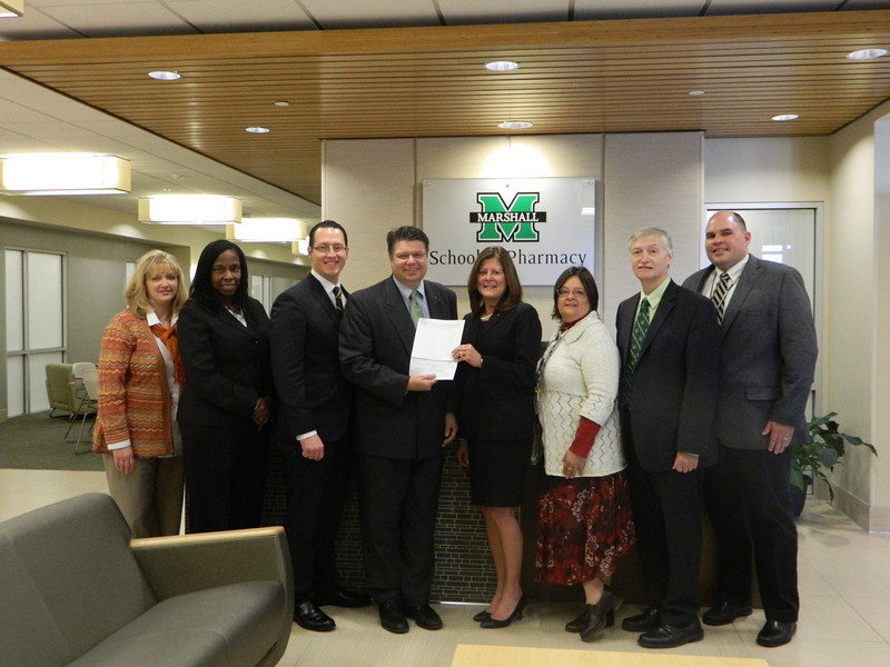 H. Glenn Anderson, Marshall University School of Pharmacy Associate Dean for Academic Affairs, accepts a check from Deborah Harris, Walgreens Corporation.   Also pictured from left: Terri Moran,  assistant dean of student affairs, Shelvy Campbell, director of diversity,  Chris Creamer with Walgreens, Anderson, Harris, Kim Broedel-Zaugg, professor and chair, department of pharmacy practice, Robert Stanton, assistant dean of experiential learning, and Craig Kimble, director of experiential learning.