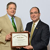 Dr. W. Mitchel Shaver (left) accepts an award for the number of graduates who enter family practice residencies from Jeff Cain, M.D., president of the American Academy of Family Physicians. Photo credit: American Academy of Family Physicians.