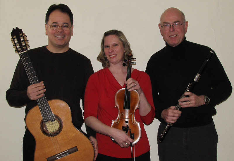 Guitarist Dr. Júlio Ribeiro Alves (left) will be joined by his wife, violinist Kristen Alves (center), and fellow faculty member, flutist Dr. Wendell Dobbs, in a program of chamber music at 8 p.m. Wednesday,  Feb. 13 in Marshall University's Smith Music Hall.