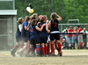 Members of the John Stark girls softball team celebrate after defeating Kennett High School, 4-3, in the New Hampshire 2009 Girls Softball Class I Tournament quarter final game, held June 6th, at Kennett High School.