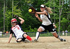 Kennett High's Molly Saunders (white shirt/black shorts) blocks the plate, preventing the John Stark player (#8) from scoring on a wild pitch. Saunders then applied the tag which kept the score tied at 3-3. John Stark later went on to win the game, held June 6th, 4-3, and move on to the next round in the state class 1 girls softball playoffs.