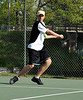 Thomas Stapinski, of Kennett High School, keeps his eye on the ball, as he readies a backhand shot on his way to a 9-8 (7-4) victory over his Oyster River opponent. The match was held 5/20/09.