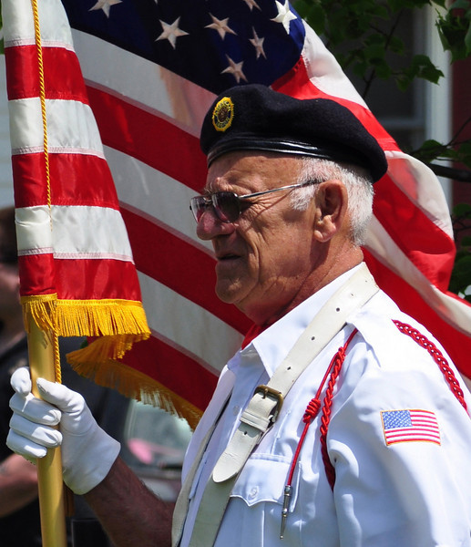 An honor guard carries the colors during the 2009 Bartlett (New Hampshire) Memorial Day Parade.