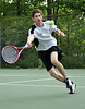 Brett Guerringue, of the Kennett High Tennis Team, stretches to return a shot at the net, during matches with Oyster River on May 20th.