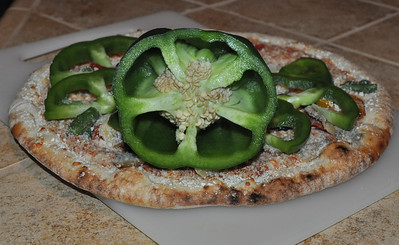 Quail Hollow Farm bell pepper can really upgrade your store-bought Trader Joe's famous organic pizza in photo from Quail Hollow Farm CSA.