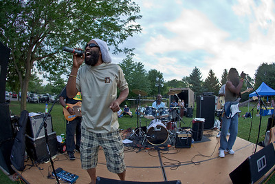 """Dodarie Haughton and his reggae band 'the Ark Band' perform at the """"Last Splash"""" at the Highlands Park Pool held Saturday July 31, 2010 in Westerville, Ohio.  The pool closed early for the season for a complete demolition and re-construction.  The new facility is expected to open on Memorial Day 2011."""