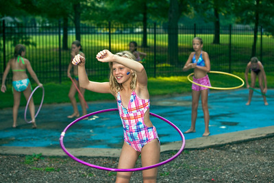 """Kaila Dent, 12, tries her hand in the hula hoop contest held at the """"Last Splash"""" at the Highlands Park Pool held Saturday July 31, 2010 in Westerville, Ohio.  The pool closed early for the season for a complete demolition and re-construction.  The new facility is expected to open on Memorial Day 2011."""