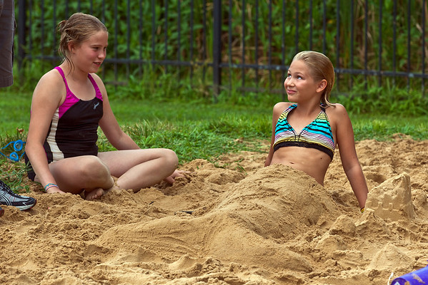 """Lyrn McKibben, 11, left, and Elana McKalip, 11, right, wait for judging in the sand sculpture contest held at the """"Last Splash"""" at the Highlands Park Pool held Saturday July 31, 2010 in Westerville, Ohio.  The pool closed early for the season for a complete demolition and re-construction.  The new facility is expected to open on Memorial Day 2011."""