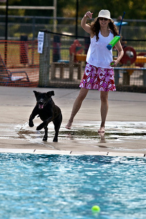 Vanessa Nelson and 'Ozzie', from Powell, play at the Big Splash Pool in Grove City Sunday afternoon September 12, 2010.  The pool held it's 3rd annual 'Soggy Doggy' pool party where K9's are the only ones allowed to swim.