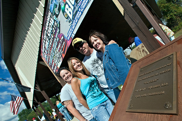 The Smith Family, left to right, Kristi Smith (sister), Cassie Smith (wife), Jim Smith and Debbie Smith (parents), pose for a photo next to the plaque dedicating the shelter house to their (son/brother/husband) at the 2010 SSG Shannon M. Smith Memorial Car & Bike Show held at the Freedom Park in Sunbury, Ohio to raise money for the scholarship funds for the fallen hero, photographed Sunday morning September 12, 2010.