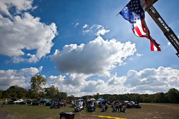 A flag hangs from the top of BST&G Ladder 351 at the 2010 SSG Shannon M. Smith Memorial Car & Bike Show held at the Freedom Park in Sunbury, Ohio to raise money for the scholarship funds for the fallen hero, photographed Sunday morning September 12, 2010.