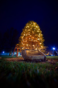 The Hudler Memorial Christmas tree on the campus of Ohio Wesleyan University Sunday evening December 5, 2010. About 100 people turned out for the third annual event which pays homage to OWU 1956 alumni Ron Hudler who died in 2008 and operated a christmas tree farm after a successful business career.   | ©James D. DeCamp | http://www.JamesDeCamp.com | 614-462-8027