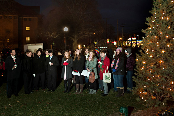 """The singing group """"Pitch Black"""" performs at the annual lighting of the Hudler Memorial Christmas tree on the campus of Ohio Wesleyan University Sunday evening December 5, 2010. About 100 people turned out for the third annual event which pays homage to OWU 1956 alumni Ron Hudler who died in 2008 and operated a christmas tree farm after a successful business career.   