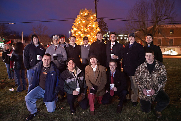 at the annual lighting of the Hudler Memorial Christmas tree on the campus of Ohio Wesleyan University Sunday evening December 5, 2010. About 100 people turned out for the third annual event which pays homage to OWU 1956 alumni Ron Hudler who died in 2008 and operated a christmas tree farm after a successful business career.   | ©James D. DeCamp | http://www.JamesDeCamp.com | 614-462-8027