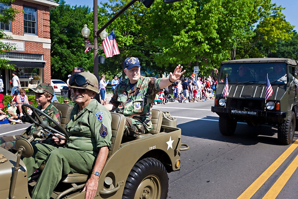 Air Force veteran Charlie Hays waves to the crowd from a Motts Military Museum jeep during the Worthington Memorial Day Parade held Monday May 30, 2011 on High Street in downtown Worthington.