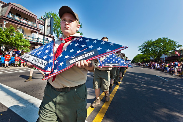 Will Foster, 12, with Boy Scout Troop 123, and his other troop members carry flags of fallen servicemen during the Worthington Memorial Day Parade held Monday May 30, 2011 on High Street in downtown Worthington.
