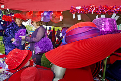 l-r: Toni Gilbert and Brenda Volpe, both from Hilliard, look over a vendors wears during a gathering of the Red Hat Ladies at Weaver Park in Hilliard, Ohio Sunday afternoon September 25, 2011.  Several dozen ladies from through-out the state attended the event.
