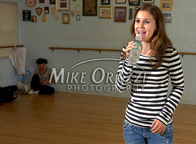 9/27/2008 Mike Orazzi | The Bristol Press 2009 Miss Bristol Pageant contestant Nicole Paquette uses a bottle of water to simulate a microphone while practicing her talent for the Miss BristolPageant at the Dance Arts Center on Saturday morning. Waiting her turn is Dana Brooks.