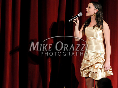 10/4/2009 Mike Orazzi | The Bristol Press Teen Miss Bristol 2008 Molly Westfall sings the National Anthem at the Miss Bristol 2009 Scholarship Pageant at Bristol Central High School.