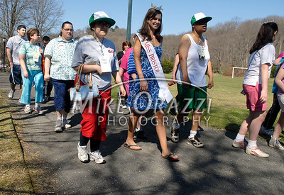 4/25/2009 Mike Orazzi | Staff Miss Bristol 2009 Nicole Paquette (center) during a 2 mile walk to raise funds for the Children's Miracle Network held in Rockwell Park on Saturday morning.