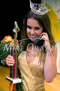 10/4/2009 Mike Orazzi | The Bristol Press Nicole Paquette talks on a cell phone after being crowned Miss Bristol 2009 during Saturday night pageant at Bristol Central High School.