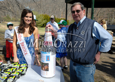 4/25/2009 Mike Orazzi | Staff Bristol Mayor Art Ward makes a donation as Miss Bristol 2009 Nicole Paquette looks on before the start of a 2 mile walk to raise funds for the Children's Miracle Network held in Rockwell Park on Saturday morning.