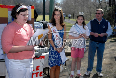 4/25/2009 Mike Orazzi | Staff Miss Bristol 2009 Nicole Paquette listens as Katie Kelly reads her first place essay before the start of a 2 mile walk to raise funds for the Children's Miracle Network held in Rockwell Park on Saturday morning. At right is Miss Connecticut Diamond Trinette Robinson and Bristol Mayor Art Ward.