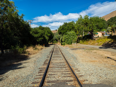 Railroad Tracks. Sunol, CA, USA  Photo from the Niles Canyon Stroll & Roll event. For the event, the section of State Route 84 between Sunol, CA and Fremont, CA is closed down for pedestrians and bikers.