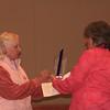 Barbara presenting trophy to Noel
